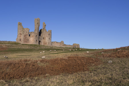 headland: Dunstanburgh Castle lies on a spectacular headland on the coast of Northumberland in northern England