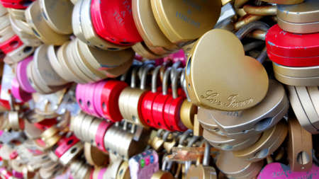 swear: Osaka  Jan 2016: Locks on Umeda Sky Building, the heart locks shape that couples use for swear their love and lock together at the top of Umeda Sky Building on 16 January 2016 in Osaka, Japan