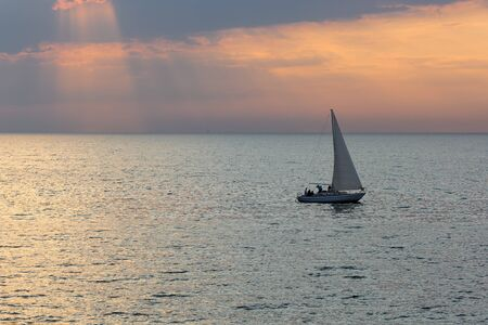 Seascape view with yacht in morning light
