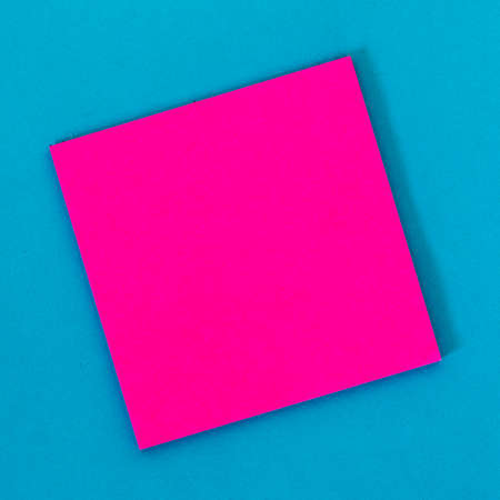 Pink empty note paper with blue background.