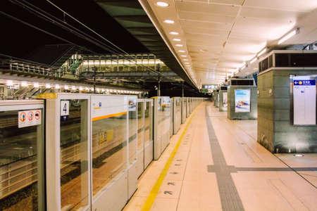 Lantau Island, Hong Kong, China - December 29, 2013: Hong Kong MTR Sunny Bay Station Platform at Nighttime