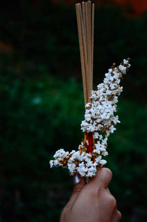 popped: Popped rice and joss stick on hand