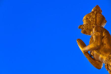 garuda: Golden garuda statue with blue background