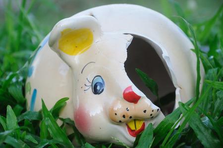 ovule: Broken Rabbit Ceramic in the Garden Stock Photo