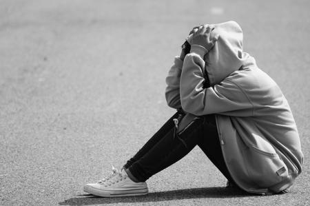 dolorous: Nervous Girl Sitting on Street