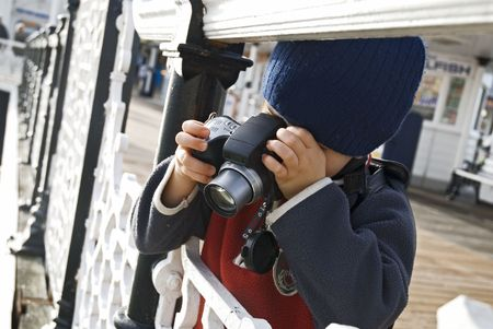 Kid taken pictures with a compact camera