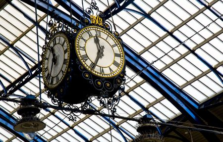 pm: clock hanged from the roof of brighton train station, east sussex, uk