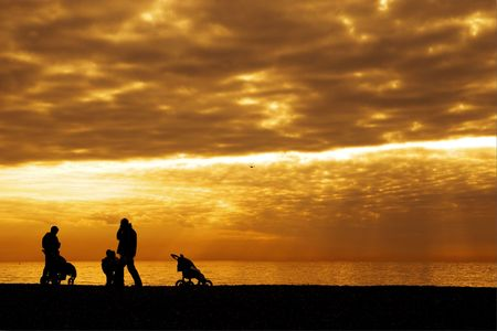 silhouetted with an orange and yellow sky as background
