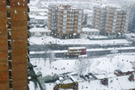 A snowed street viewed trough a window, brighton, east sussex, uk Stock Photo