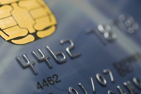 chip and pin: CLOSE UP OF A BLUE CREDIT CARD