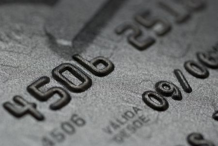 CLOSE UP OF A SILVER CREDIT CARD