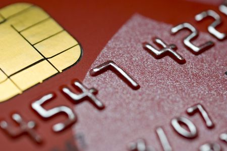 chip and pin: CLOSE UP OF A RED CREDIT CARD