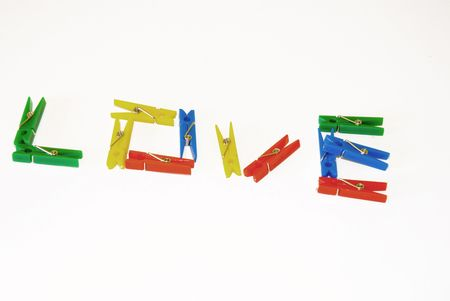 clothes peg: love word made out of clothes peg Stock Photo