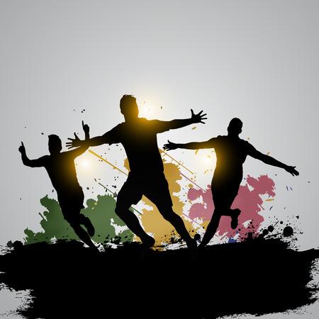 三サッカー選手は、ゲームの勝者を祝う