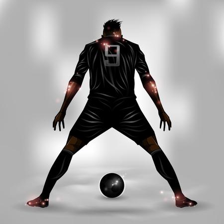 jugador de futbol: Jugador de fútbol a punto de disparar una pelota de fútbol