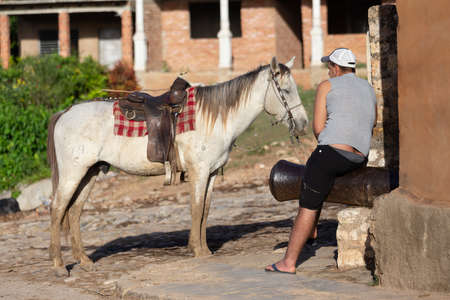 Trinidad, Cuba 16.12.2018 Horse and rider in the streets of Cuban town