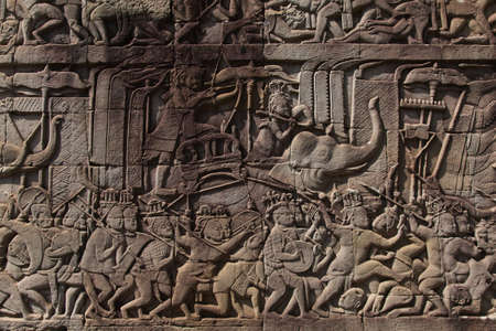 The temple complex of Angkor Watt, Cambodia wall relief depicting ancient wars Foto de archivo