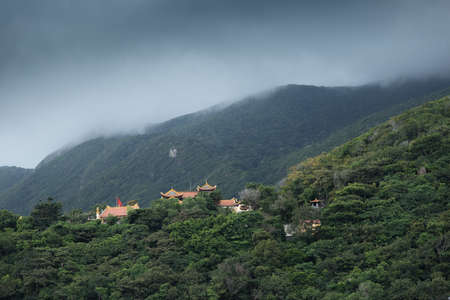 Con Dau, island from Vietnam, Van Son Pagoda in mountains with storm clouds
