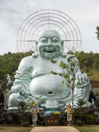 Linh An pagoda central Vietnam with famous huge silver smiling buddha Banco de Imagens