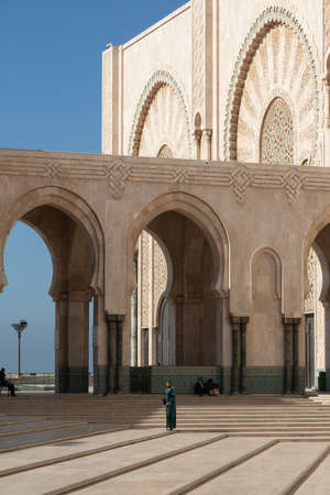 Hassan 2 mosque in Casablanca Morocco 12/31/2019 with arches and blue sky Banco de Imagens