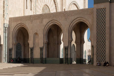 Hassan 2 mosque in Casablanca Morocco 12/31/2019 with arches and seated visitors