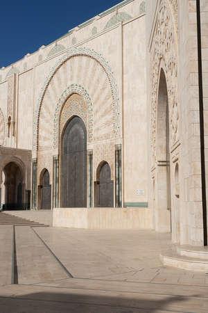 Hassan 2 mosque in Casablanca Morocco 12/31/2019 with doorway arch and blue sky Banco de Imagens