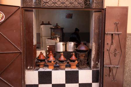 Marrakech, Morocco, 01/12/2020 small shop showing kitchen selling tagine Banco de Imagens