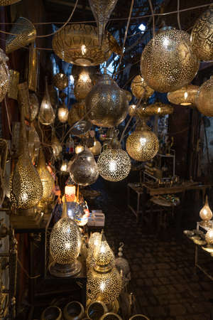 Marrakech, Morocco, 01/12/2020 market stall traders in the souk selling lamps Banco de Imagens