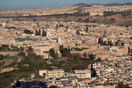 Fes Morocco cityscape with medina in centre seen from hills above in bright sun Banco de Imagens