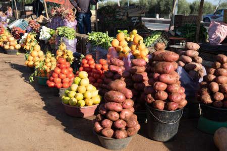vegetables piled into pyramids in street market in Morocco Banco de Imagens