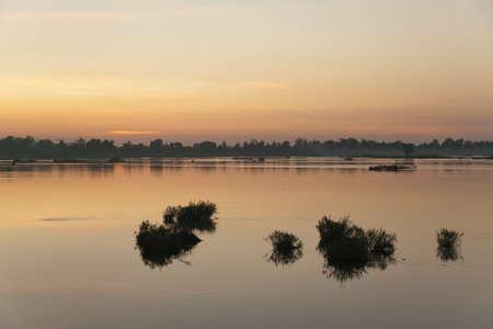 Muong Khong Laos 1/12/2012 Mekong river at dawn with golden sun rise over water Banco de Imagens
