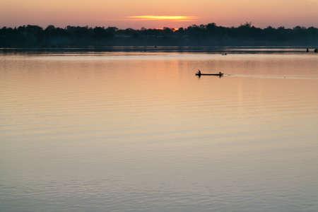 Muong Khong Laos 1/12/2012 Mekong river at dawn with golden sun and fishing boat