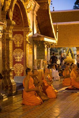 Wat Phra That Chang Mai Thailand 12.9.2015 monks praying golden Buddhist temple