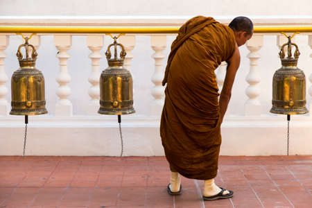 Chiang Mai, Thailand 12.11.2015 monk ringing ceremonial religious bells