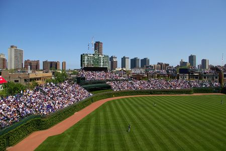 large crowd: Baseball stadium with a large crowd on a sunny day Stock Photo