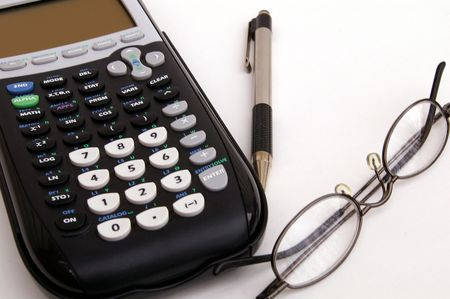 bifocals: Calculator, pen, and glasses on a white background