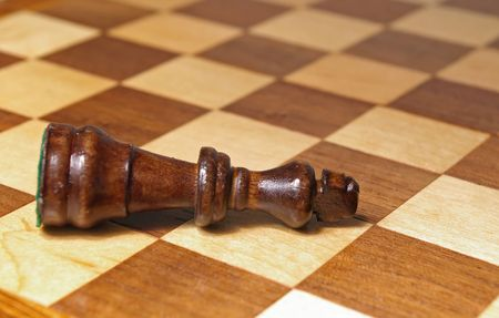 Black chess king laying on one side Stok Fotoğraf