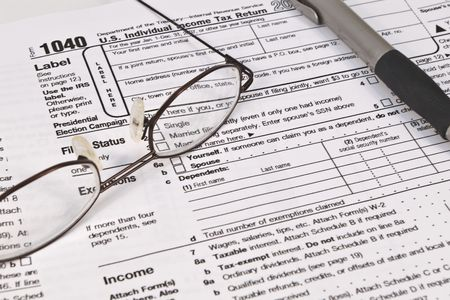 IRS 1040 form wit glasses and a pen