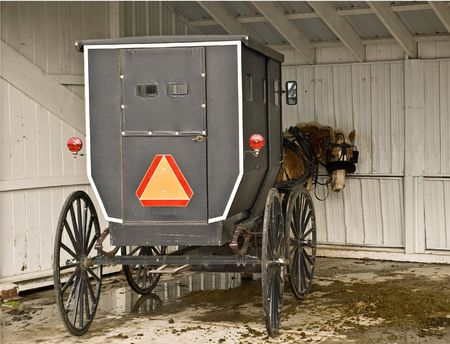 amish buggy: Amish horse and buggy parked in a livery stable