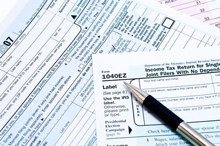 IRS 1040EZ income tax forms with pen
