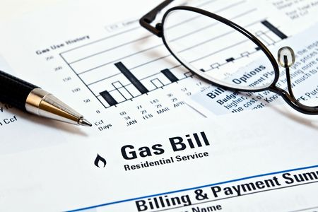 white winter: Monthly natural gas heating bill with glasses and pen Stock Photo