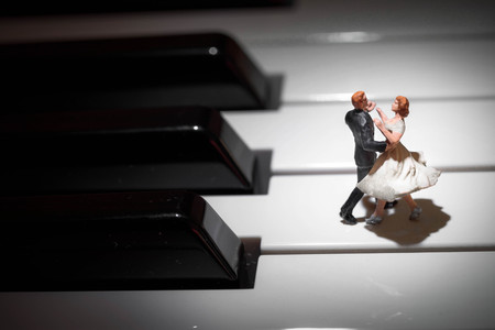 miniature dancing couple on a piano