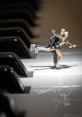 miniature figure skating couple on a piano