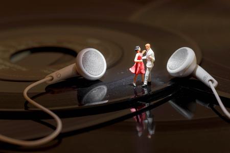 miniature couple dancing on vinyl records