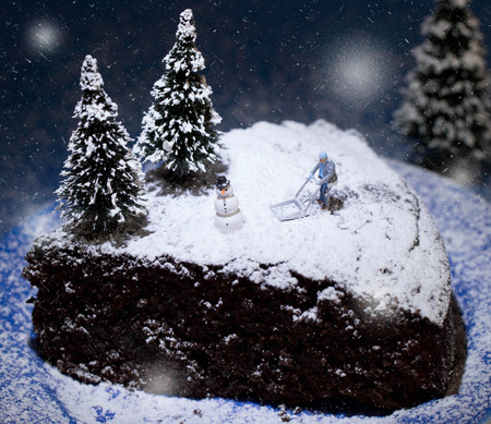 miniature people on a chocolate cake winter landscape
