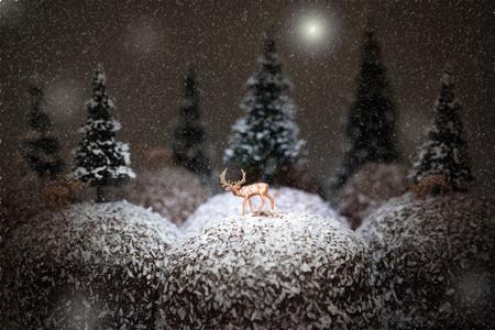 winter landscape, deer on chocolate covered cream cake