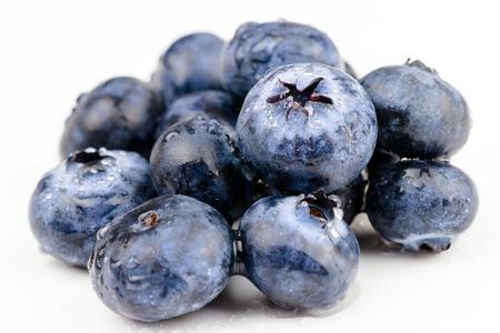 fresh blueberries on white background Фото со стока