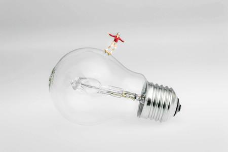 skater on a light bulb Фото со стока