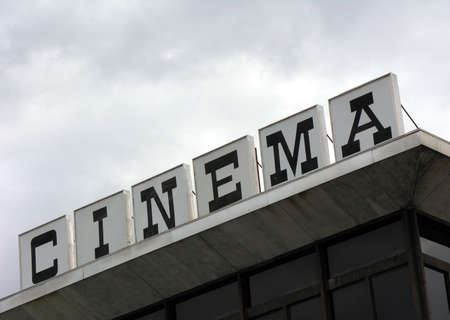 atop: Sign atop a movie theater