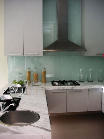 Modern kitchen, counter, stove, hood, sink photo